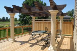 Cedar deck with cedar fencing and screen, metal spindles and a Tuscany pergola overhead from the Great Outdoor Company and Fireplace Pros.