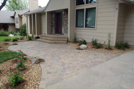 Front entry stoop and steps with 3 piece cobblestone paver entrance walk.